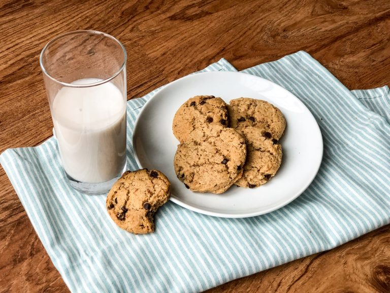 Vegan Gluten Free Chocolate Chip Cookies with a glass of almond milk