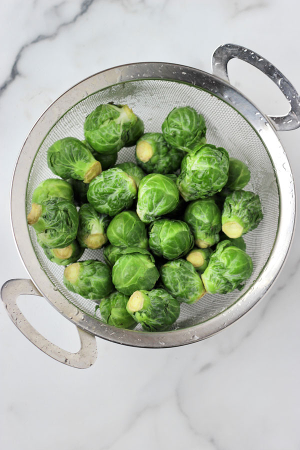 Brussels sprouts in strainer