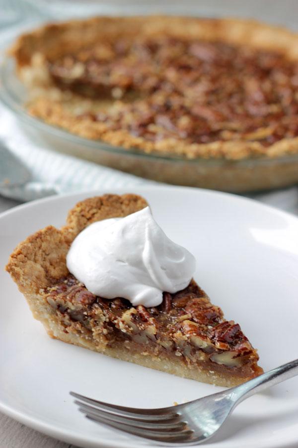 Pecan pie slice on white plat