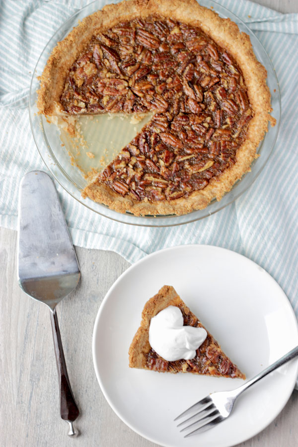 Pecan pie on cooling rack and slice