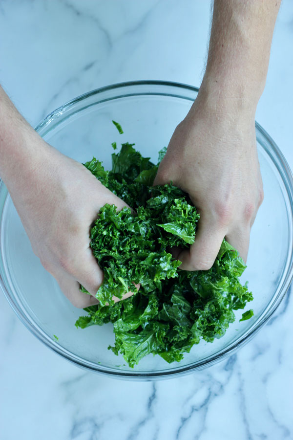 Hands massaging kale