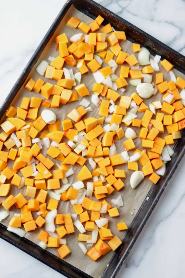 butternut squash, onion and garlic on a sheet pan