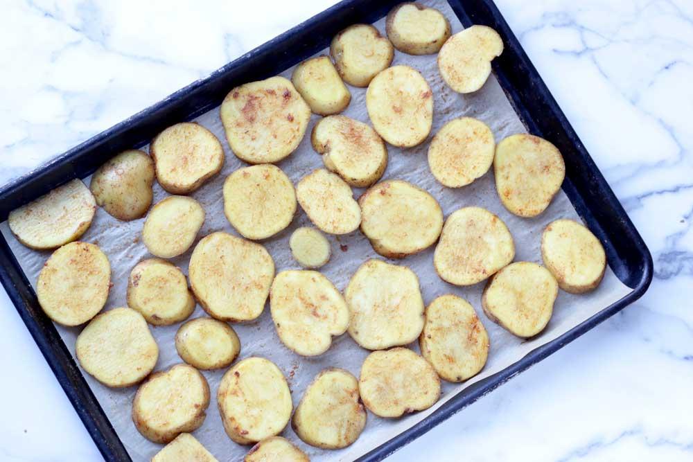 Potato slices on a sheet pan