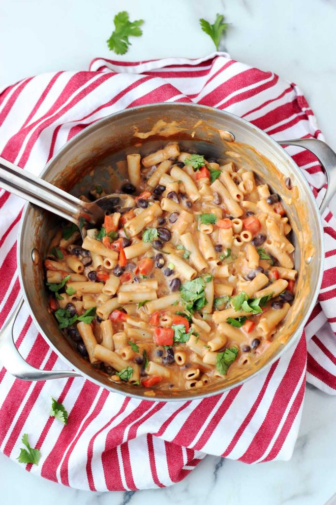 Vegan taco pasta in pan on red and white towl