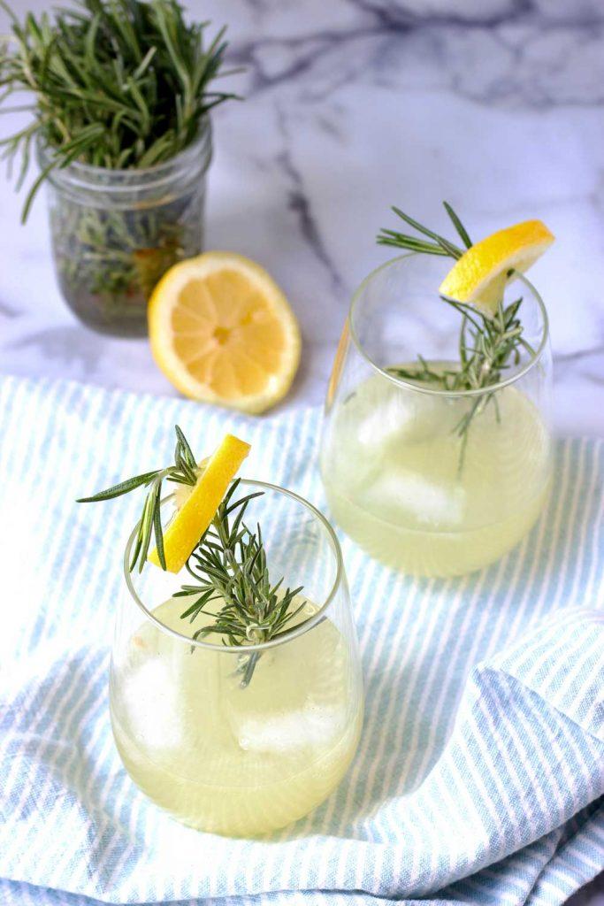 Rosemary Ginger lemonade in wine glasses