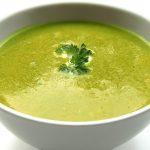 Green soup in a white bowl